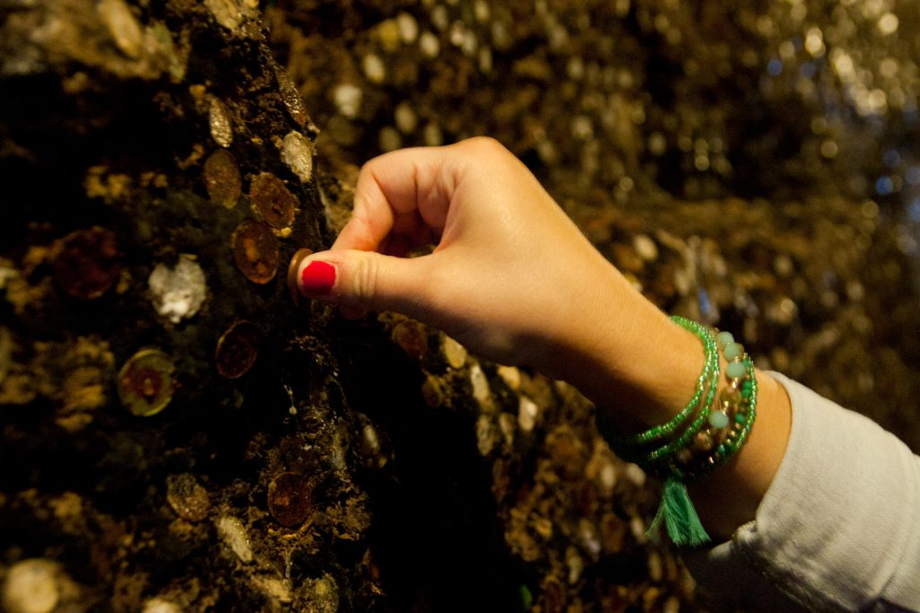 Stick a coin on a wine cellar wall